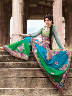 Get a perfect look for the party in this designer traditional lehenga. It has dual color in it and the entire saree has floral pattern in it made of thread work.  The designer border on the saree with similar designer blouse adds an oomph factor to it.  (Slight variation in color is possible)