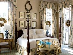 English garden inspired bedroom 29.  I like the pictures on the wall behind the bed.