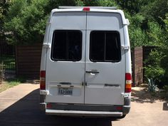 Adding some windows in the rear doors of a Sprinter T1N will give you more light in the back in the van and better air circulation with sliding windows. Mercedes Sprinter Camper, Sprinter Van, Sliding Windows, Windows And Doors, Van Storage, Class B Rv, Storage Places, Solar Panel Installation, Solar Panels