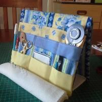 Sewing : My Tooly Tool Easel.  Board like ones inside picture frame.  A few favorite fabrics.