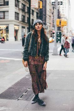 Natalie Suarez of Natalie Off Duty wears a floral dress, tights, lace-up shoes, a cropped jacket, and beret and a shoulder bag