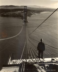 Footbridge ropes stretch across the Golden Gate Bridge under construction. San Francisco, California, September Photograph by Charles M. The bridge celebrated its anniversary this past Sunday! Bridge Construction, Construction Worker, Construction Design, Under Construction, Construction Business, Construction Birthday, Puente Golden Gate, Global Icon, San Francisco