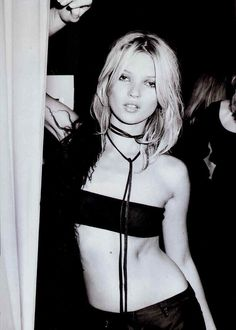 Kate Moss in Gucci by Tom Ford, Spring 1996. (I wonder how much that skimpy tube top costed then...$250?)