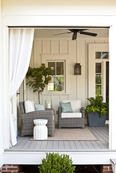 love the wall treatment, soft colors and greenery on this porch, would be great in the conservatory.