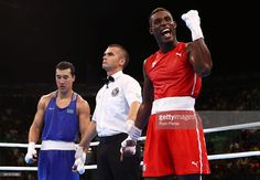 Julio Cesar La Cruz (R) of Cuba celebrates after winning gold against Adilbek Niyazymbetov of Kazakhstan in the Men's Light Heavy (81kg) event on Day 13 of the 2016 Rio Olympic Games at Riocentro - Pavilion 6 on August 18, 2016 in Rio de Janeiro, Brazil.