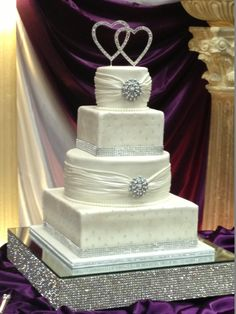 "- ""I want lots of bling"" cake.  The bride brought me a picture so I can't take full credit for the design."