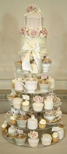 Rustic vintage cupcake tower with a gorgeous wedding cake on top - love the pearls and flowers on the cupcakes #baby shower