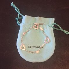 Tiffany & co hearts toggle bracelet Item is Pre-Owned, but has recently been cleaned and polished. Item Includes Draw String Pouch, only wore once. Real tiffanys Tiffany & Co. Jewelry Bracelets