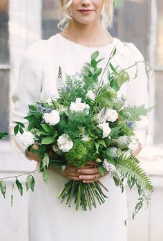 Modern Bouquet with Gardenias & Thistle. A white-and-green bouquet comprised of gardenias, herbs, ferns, roses, and thistle, created by Brown Bunny Flowers.
