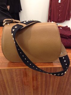 Valentino leather saddle bag with rockstud strap is your perfect cross-body boho-chic accessory for all seasons!