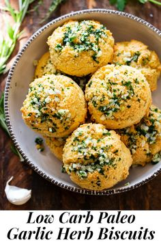 #AD These easy, one bowl garlic herb biscuits are keto and paleo-friendly, but you'd never guess! Fluffy grain-free biscuits with a crisp outside and soft inside with savory fresh herbs are topped with a buttery garlic herb sauce. They're perfect for your holiday dinner table, but quick to clean up with Reynolds Wrap Non-Stick Foil! #ReynoldsPartner @ReynoldsBrands#ReynoldsPartner #paleo #keto #lowcarb #cleaneating
