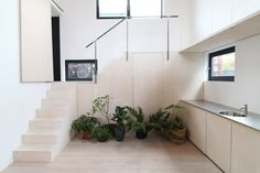 Julius Taminiau creates compact living spaces inside Japanese-inspired houseboat