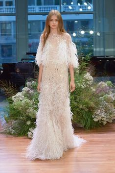 This fabulously feathered and sequined Monique Lhuillier gown. | 27 Ridiculously Pretty Wedding Dresses To Look At While The World Burns