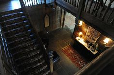 A staircase in the mansion on the property at 124 Old Mill Rd. in Greenwich, Conn. Thursday, Jan. 15, 2015.  The 15,862 sq. ft. house on 75.7 acres was formerly owned by movie star Mel Gibson.  The mansion built in 1926 has 15 bedrooms, 10 full- and seven half-baths, a pool, movie theater, tennis court, stables, pond, outdoor hedge maze and life-sized outdoor chess board. Photo: Tyler Sizemore / Greenwich Time