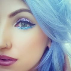 Love, love, LOVE this. I wish I could dye my hair that color. And that eyeshadow - wow!