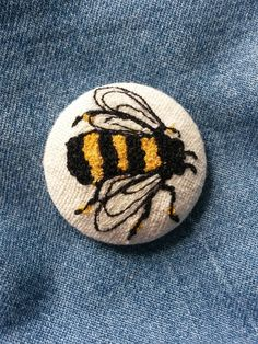 Stitched Bee brooch. I have used free motion embroidery to create this tiny piece of textile Art, the design is sewn onto cream or white
