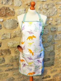 Dinosaur pocket apron  unique dinosaur print pinny Make A Dinosaur, Apron Pockets, New Home Gifts, Uk Shop, Gift For Lover, Aprons, Color Splash, Printing On Fabric, How To Draw Hands