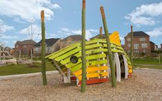 The Brook Trout sculpture provides space for activity or for quieter passive recreation. The log jam is the most active feature in the custom play structure King City, Sport Park, Sand Play, Playhouse Plans, Kid Experiments, Natural Playground, Playground Design, Kids Room Design, Parks And Recreation