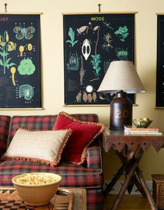 trick for styling around boldly-patterned sofa. hang large-scale prints or art above with colors that tie into sofa. cozy and connected result.