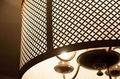 I wanted a drum shade for my dining room chandelier. So I got some embroidery hoops, a radiator grate, a cheap piece of styrene and some tape. Illumination Challenge! GO!