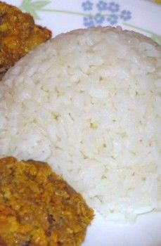 Dominican style rice. Salty and oily. The best with rice and beans.--blog has lots of Dominican food my friends.