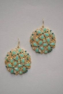 These round, gold scroll earrings are set with mint stones arranged in floral shapes to help bring in spring!