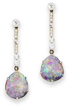 A pair of art deco black opal and diamond pendent earrings, circa 1925 Each claw mounted drop-shaped black opal, suspended from an articulated surmount composed of collet mounted old brilliant-cut diamonds spaced by two millegrain-set single-cut diamond sections, length 4.4cm., cased by Hardy Bros. Ltd., Australia