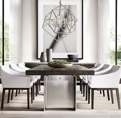 RH Modern's Beam Rectangular Dining Table:Drawing inspiration from the Industrial Age, our table offers a stunning juxtaposition of reclaimed wood and solid metal. Designed by Thomas Bina and Ed Robinson, the oak tabletop seemingly floats above two smooth I-beam supports, the contrast of materials bringing textural and tonal interest to the sleek, modern form.