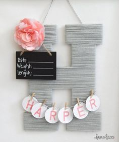 A personalized wooden letter covered in soft acrylic yarn and embellished with an item to match your babys nursery! Great to take to the hospital