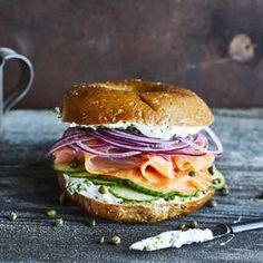 Starting with smoked salmon, this bagel sandwich is layered with tasty ingredients—flavored cream cheese, capers, and purple onion. It's a quick fix for a brown-bag lunch Breakfast Sandwich Recipes, Breakfast Bagel, Bagel Sandwich, Brunch Recipes, Breakfast Ideas, Easter Recipes, Smoked Salmon Bagel, Smoked Salmon Recipes, Smoked Salmon Breakfast