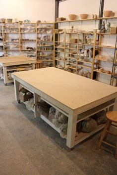 IVAR shelves from Ikea. Simple wooden tables with space to store clay and a shelf for drying slabs