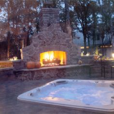 A hot tub AND an outdoor fireplace!