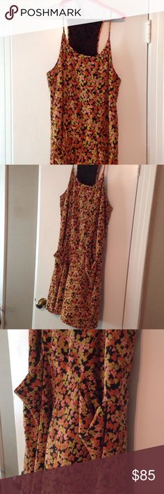 Theory racer back floral sack dress Theory size 8. Racer back and spaghetti straps. Length just below knee. Pockets!!!! Hangs for casual fit. Orange, coral, yellow floral print all over. Theory Dresses Midi