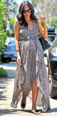 Zoe Saldana made a graceful appearance at Jennifer Klein's Day of Indulgence event in a flowy printed maxi dress, complete with a long pendant, a selection of bracelets, and embellished flat sandals.