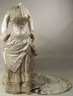 fripperiesandfobs:    Wedding dress, 1882  From the Manchester Art Gallery