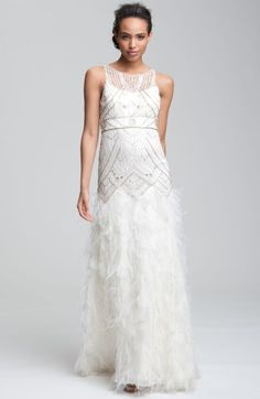 Free shipping and returns on Sue Wong 'Feather' Beaded Gown at Nordstrom.com. An art deco pattern of sequins and metallic beadwork covers the drop-waist mesh bodice—unlined at the back—of a stunning gown finished with a skirt covered with organza petals and wispy ostrich feathers.