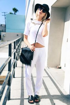 Browse the best summer street style outfit ideas at @stylecaster | 'Peace Love Shea' blogger in white separates, black accessories