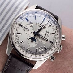 Zenith El Primero 410 Complete Calendar Chronograph: a non-limited edition with a silver sunray dial! This 42 mm stainless steel beauty houses the automatic El Primero 410 with time, date, day of the week, month, moon phases and chronograph functions