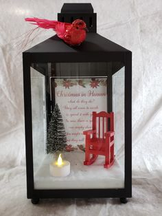 Christmas In Heaven Lantern with Red Chair lanterns Christmas Chair, Christmas Holidays, Christmas Ornaments, Decorating Lanterns For Christmas, Christmas In Heaven Ornament, Outdoor Christmas, Rustic Christmas, Christmas Lights, Christmas Projects