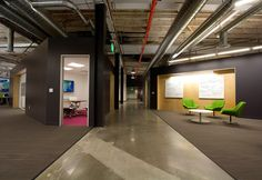 The use of raw building design components is an innovative design that provides a unique look and can reduce the direct construction cost to save capital funds or redirect them to other areas such as furnishings.  Notice the polished concrete floor, exposed ductwork and piping, and structural elements.  Skype Headquarters in San Francisco