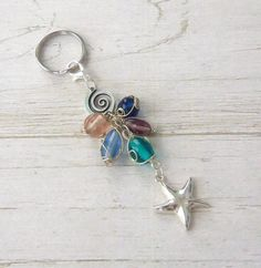 Wire Wrapped Glass Bead Spiral Starfish Key Chain / Convertible Purse Charm. $3.99, via Etsy.
