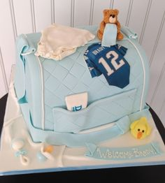 23 Scrumptious Diaper Bag Cakes for Baby Showers Want to give a fantastic present at a baby shower, or maybe you want your guests to enjoy something really special. Diaper bag cakes are the solution…. Baby Shower Cakes For Boys, Baby Shower Diapers, Baby Boy Shower, Baby Showers, Diaper Bag Cake, Boy Diaper Bags, Diper Bags, Christening Cake Boy, Shower Bebe