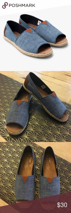TOMS Chambray Open Toe Alpargatas A twist on classic TOMS slides with Chambray upper and espadrilles like lowers and leather TOMS logo in the back. Size 7 and in perfect condition! Toms Shoes Flats & Loafers