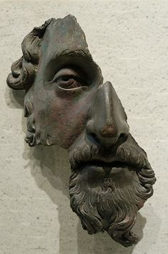 Marcus Aurelius, Bronze, Louvre    Fragment of a bronze portrait. Roman artwork, after 170 CE.