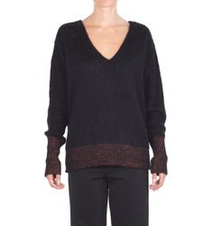 8pm - Sweater - 300194 - Black - 193,00 € Reversible over sweater.Front boat neck.V-neck on the back.Long sleeve.Glitter inserts on cuffs and hem.Fabric composition: 33% Polyacrylic, 24% polyamide, 24% mohair wool, 15% viscose, 4% polyester.Made in Italy.The model wears the XS size and is 175 cm high.