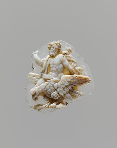 An ancient Greek or Roman sardonyx cameo fragment portraying the supreme Graeco-Roman god, Zeus/Jupiter astride an eagle, his symbolic attribute; the eagle is clutching a bundle of the god's thunderbolts. (Metropolitan Museum of Art)