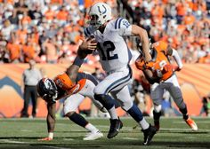 Indianapolis Colts quarterback Andrew Luck runs against the Denver Broncos during the second half in a NFL football game, Sunday, Sept. 18, 2016, in Denver.