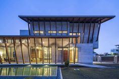 The Sepang House is defined by a large sheltering roof with deep overhangs, shaded terraces and balconies along its edges. It uses raw concrete, bricks and w...