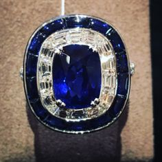 Killer No Heat Madagascar Sapphire with diamonds and Bufftop Sapps perfectly framing the gorgeous ring by Picchiotti