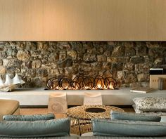 {Modern Stone Fireplace Design by Pattersons Architects} I love the rustic look a stone fireplace gives a room!
